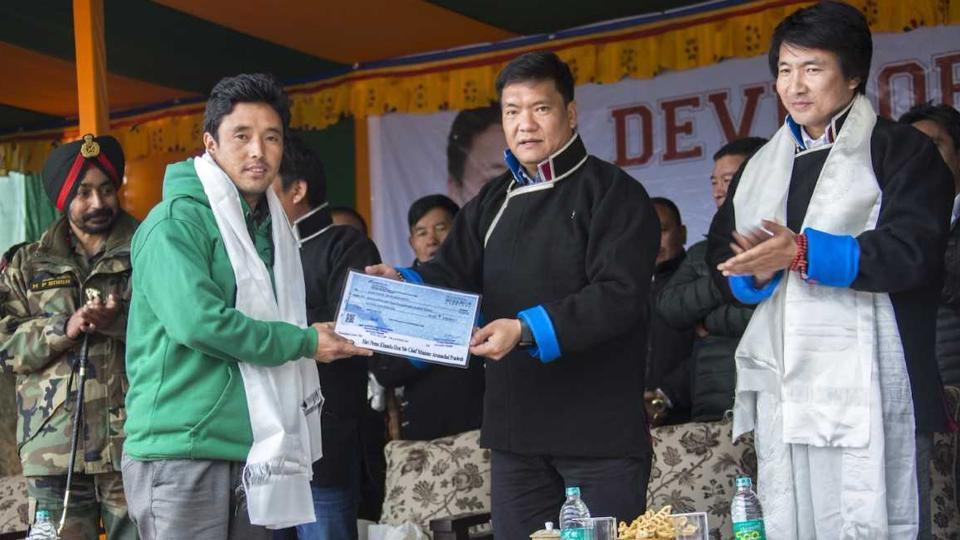 Arunchal Pradesh chief minister Pema Khandu hands over a compensation cheque to a Bomja resident at a function on Wednesday.