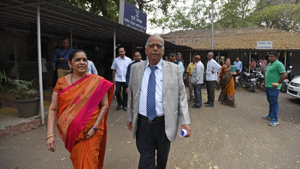 DS Kulkarni (right) along with his wife Hemanti at Economic Offences Wing (EOW) in Pune on Wednesday.