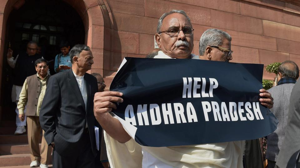 Congress leader KVP Ramachandra Rao holding a placard during a protest demanding 'Help for Andhra Pradesh' at Parliament House during the Budget Session in New Delhi on February 2.
