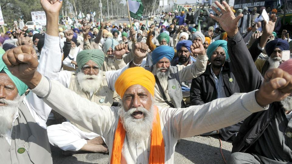 Farmers raise slogans against the Punjab government while blocking a highway towards Sangrur on the outskirts of Patiala on Wednesday.