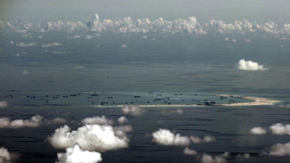 An aerial photo taken though the window of a plane shows the alleged on-going land reclamation by China in the South China Sea.