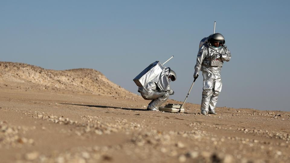 Two scientists in spacesuits, stark white against the auburn dunes, test a geo-radar built to map Mars by dragging a flat box across the rocky sand. But this isn't the red planet — it's the Arabian Peninsula. The desolate Dhofar desert in southern Oman resembles Mars so much that more than 200 scientists from 25 nations chose it as their location for the next four weeks, to field-test technology for a manned mission to Mars. (Karim Sahib / AFP)
