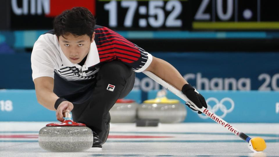Kijeong Lee of South Korea delivers the stone during the curling practice. (REUTERS)