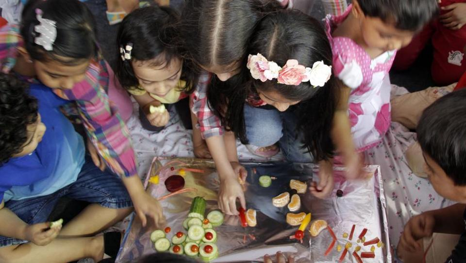 Children take part in the workshop at Kala Ghoda on Wednesday.