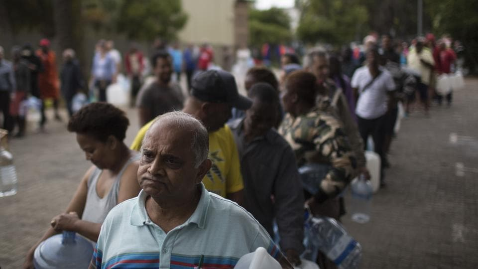 "Residents wait in a queue to fill containers with water at a source for natural spring water in Cape Town South Africa on February 02, 2018. The drought-hit city of Cape Town introduced new water restrictions this week in an attempt to avoid what it calls ""Day Zero,"" a day in May when it might have to turn off most taps. Residents have now been asked to use no more than 50 liters of water daily. (Bram Janssen / AP)"