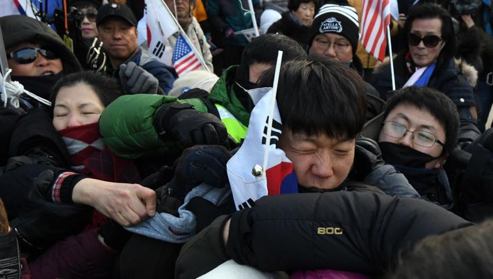 Anti-North Korea protesters struggle with police during a rally ahead of the Pyeongchang Winter Olympics.