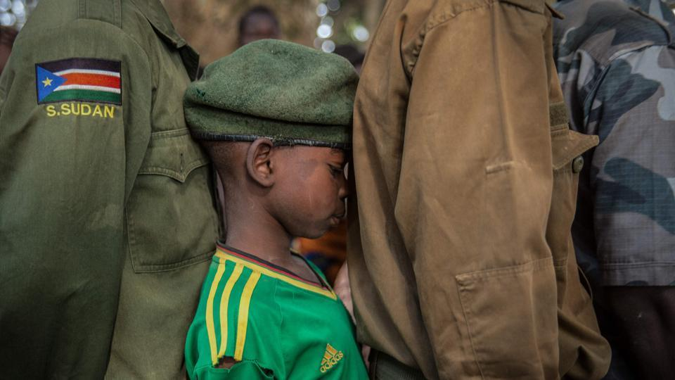 Newly released child soldiers wait for their registration during a release ceremony in Yambio, South Sudan. More than 300 child soldiers, including 87 girls, were released under a programme to help reintegrate them into society, the UN said on February 7, 2018. Conflict erupted little more than two years after South Sudan gained independence from Sudan in 2011, uprooting nearly four million people. (Stefanie Glinski / AFP)