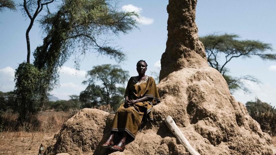 Mary Kiza, an activist against FGM, poses next to an anthill after a meeting of anti-FGM group PERUR in Alakas village. In neighbouring Kenya, around a fifth of women aged 15 to 49 have been cut, down from 38% in 1998, according to national data. Education was key to debunking myths which shore up the practice -- uncut women are forbidden from picking vegetables or collecting water for fear they will kill crops or dry up rivers. (Yasuyoshi Chiba / AFP)