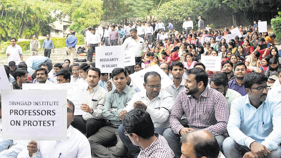 A large gathering of an estimated 1,000 employees of Sinhgad Institutes, gathered in front of the institute's corporate office, at Erandwane on Tuesday, wanting to meet the management.