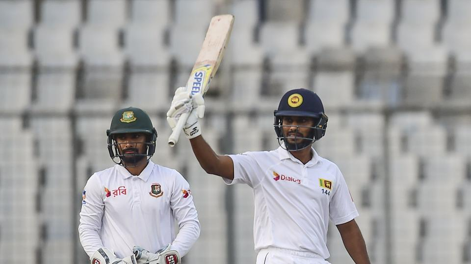 Sri Lankan cricketer Roshen Silva (R) reacts after scoring a half century as Bangladeshi wicketkeeper Liton Das (L) looks on day 2 of second Test at the Sher-e-Bangla national cricket stadium in Dhaka. Get full cricket score and highlights of Bangladesh vs Sri Lanka, 2nd Test,Day 2, in Dhaka here.