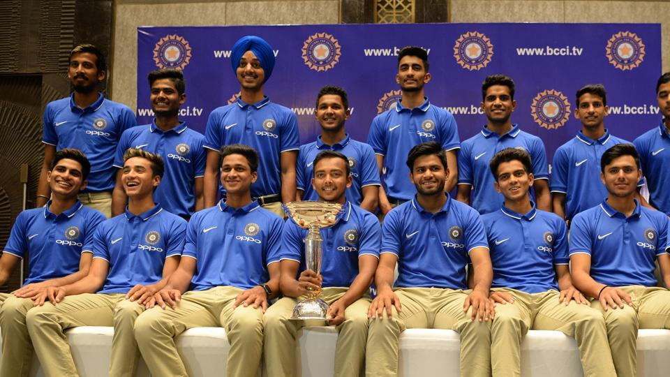 India's U19 cricket team members pose with the trophy during a news conference in Mumbai on February 5, 2018. India won the U19 cricket World Cup in New Zealand. (Punit Paranjpe / AFP)