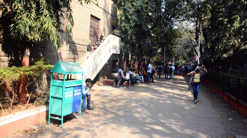 Dustbins placed at regular places to have a litter free campus at Wadia College in Pune on Monday.