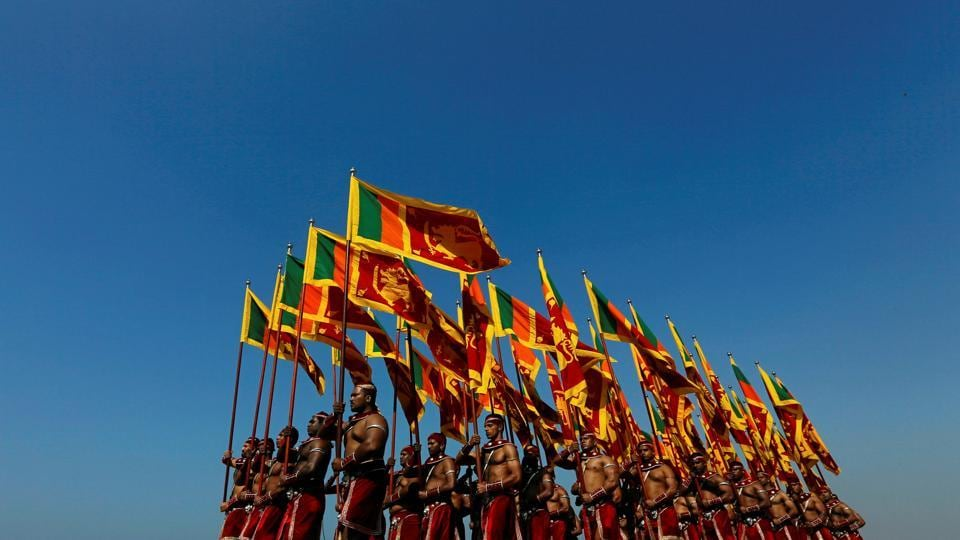 Sri Lanka's military personnel march with national flags during a rehearsal for Sri Lanka's 70th Independence day in Colombo on February 2, 2018. (Dinuka Liyanawatte / REUTERS)