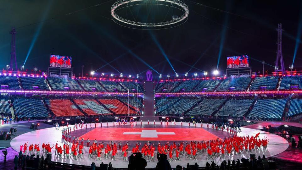 The Switzerland delegation parades during the opening ceremony. (AFP)
