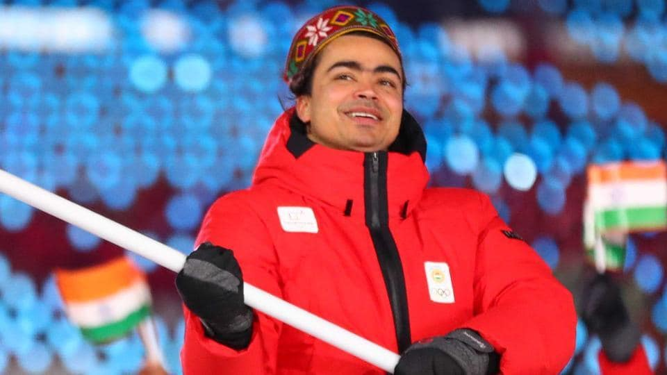 Shiva Keshavan of India carries the national flag with delegates during the 2018 Winter Olympics in Pyeongchang.