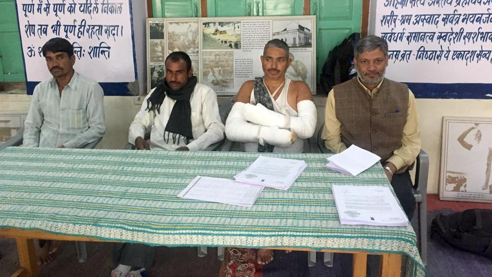 The injured whistleblowers  with civil society organisations led by Nikhil Dey (right) allege irregularities in  NREGA works in Bikaner, at a press conference in Jaipur on Friday.