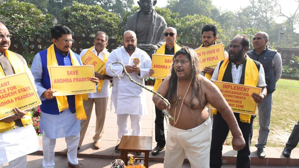 TDP MP from Chittoor N Sivaprasad along with other legislators from Andhra Pradesh protest demanding special package for the state, at Parliament in New Delhi.