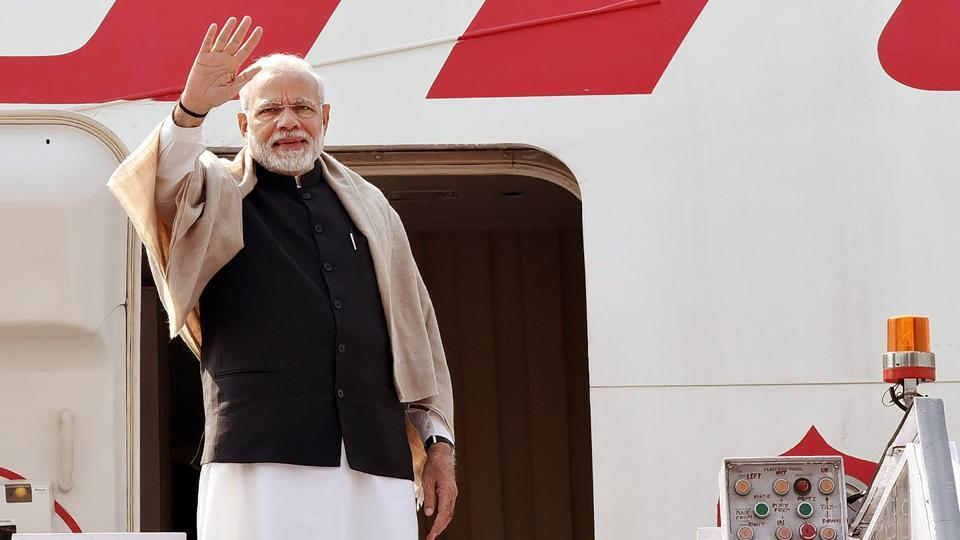 PM Narendra Modi waves as he embarks on a four-day visit to Jordan, Palestine, UAE and Oman from New Delhi on Friday.