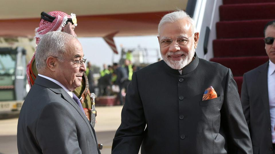 Prime Minister Narendra Modi is received by the Jordan Prime Minister Hani Al-Mulki, on his arrival, at Queen Alia International Airport in Amman.