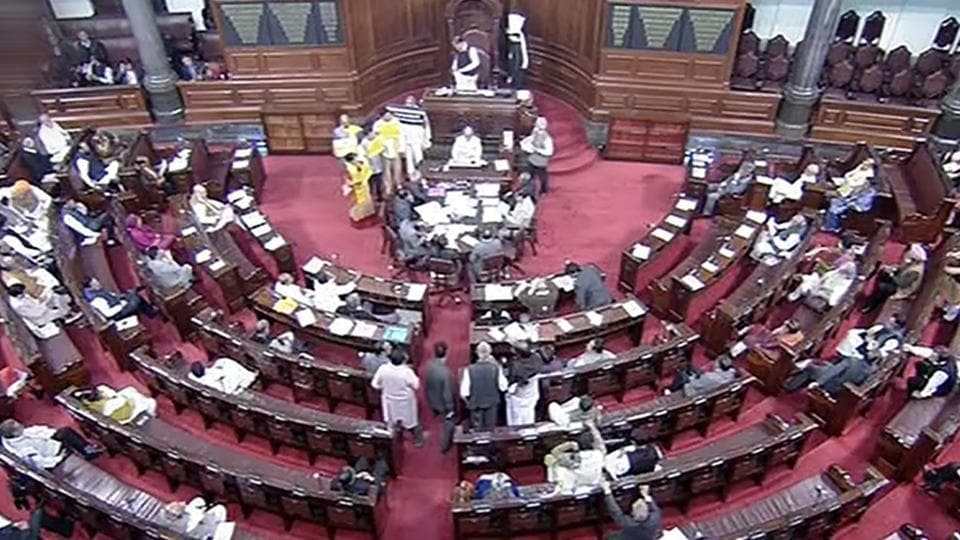 TDP members protest in the well of the Rajya Sabha, in New Delhi on Friday. PTI Photo / TV GRAB
