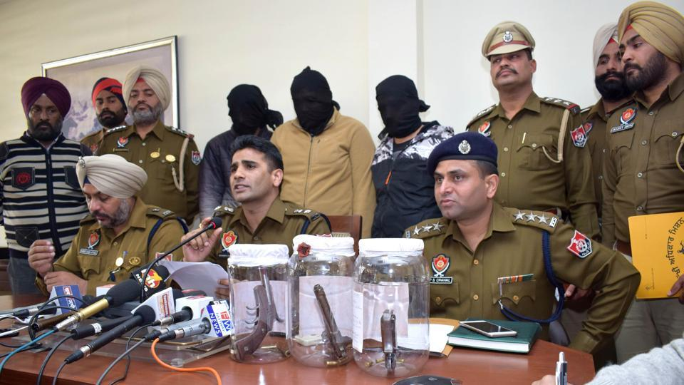 Police with the accused and seized arms during a press conference in Mohali on Thursday.