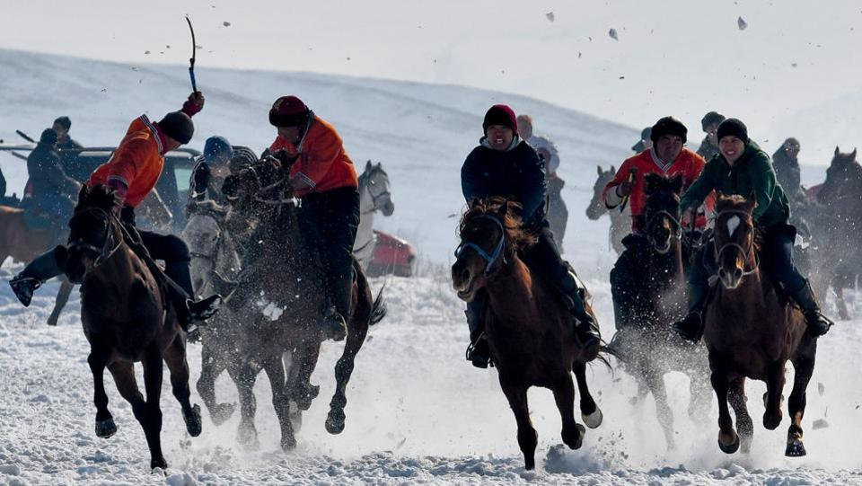 Mounted Kyrgyz riders play the traditional central Asian sport Kok-boru, know also as Buzkashi or Ulak Tartis (goat grabbing), near the village of Besh-Kungey, some 20km from Bishkek on February 4, 2018. (Vyacheslav Oseledko / AFP)