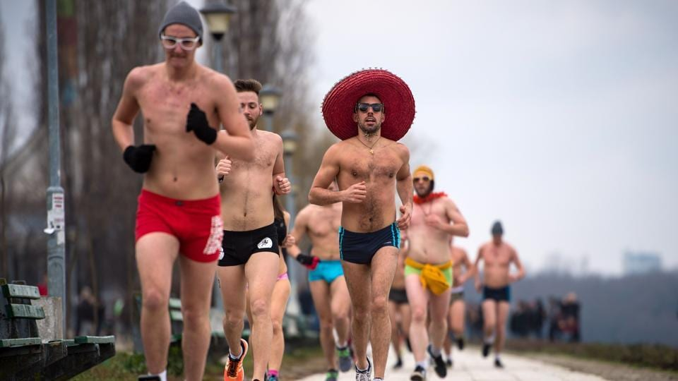 Runners take part in an Underpants Run on the banks of Danube river while outside temperatures approach zero degree Celsius in Belgrade on February 4, 2018. (Andrej Isakovic / AFP)