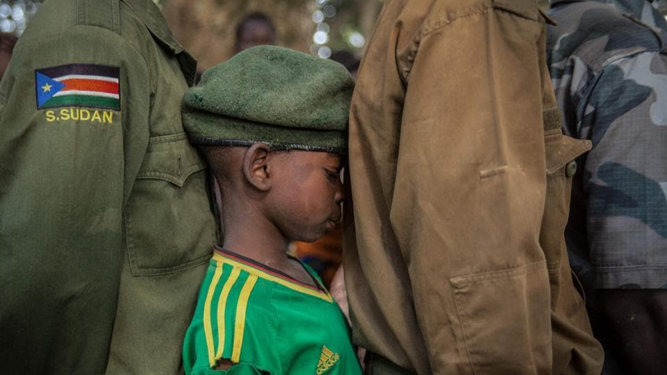 Newly released child soldiers wait in a line for their registration during a release ceremony of more than 300 child soldiers in Yambio, South Sudan, on February 7, 2018. (Stefanie Glinski / AFP)