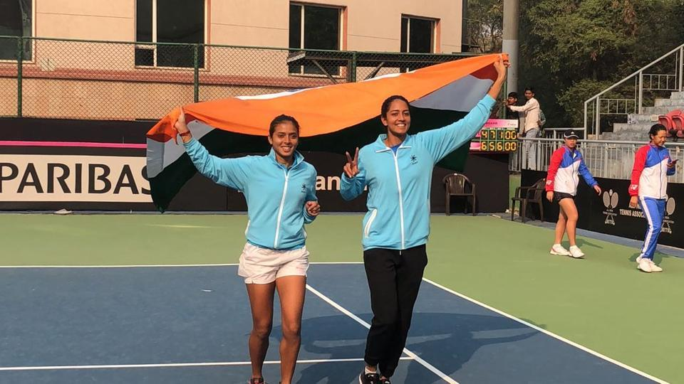 Ankita Raina (L) and Karman Kaur Thandi celebrate after winning against Chinese Taipei in the Fed Cup on Saturday.