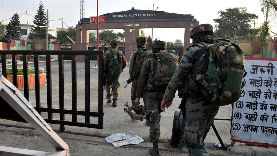 Security personnel take position during an encounter with terrorists at Sunjwan Military station in Jammu.