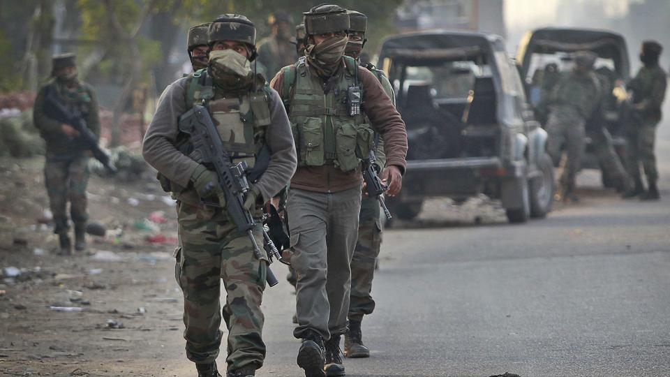Army soldiers arrive to take position at the Sunjuwan army camp in Jammu, India, Saturday, Feb. 10, 2018.