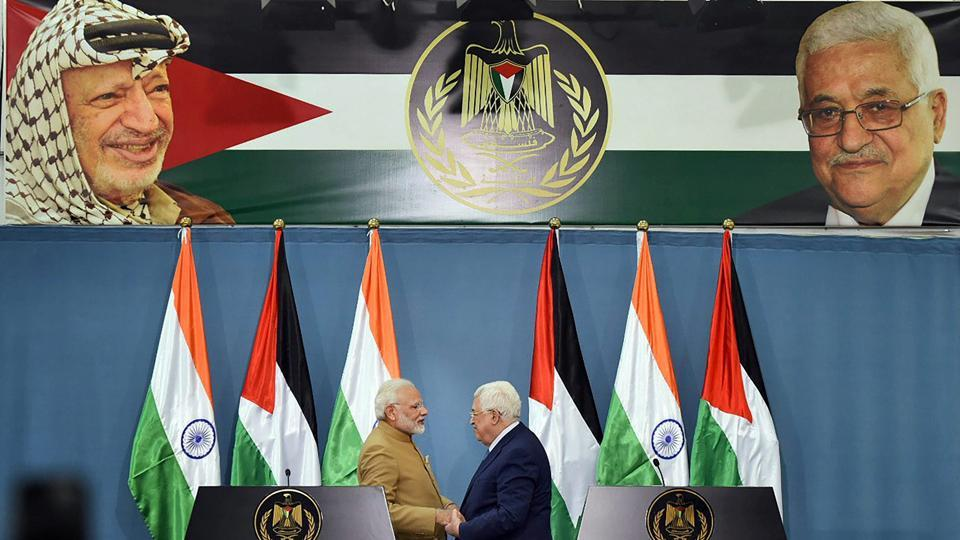 Prime Minister Narendra Modi and Palestinian President Mahmoud Abbas shake hands after the two sides signed agreements worth around $50 million during the joint press meet, at Ramallah, in Palestine on Saturday.