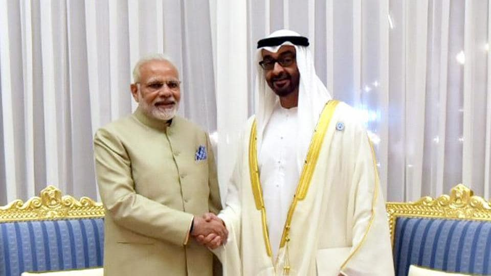 Prime Minister Narendra Modi shakes talks with the Crown Prince of Abu Dhabi Deputy Supreme Commander of UAE Armed Forces General Sheikh Mohammed Bin Zayed Al Nahyan in Abu Dhabi on Saturday