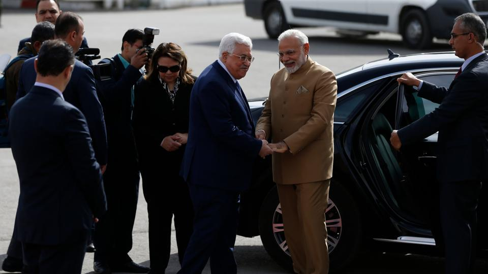 Palestinian president Mahmud Abbas (C-L) greets Indian Prime Minister Narendra Modi upon his arrival for a meeting in the West Bank city of Ramallah on February 10, 2018.