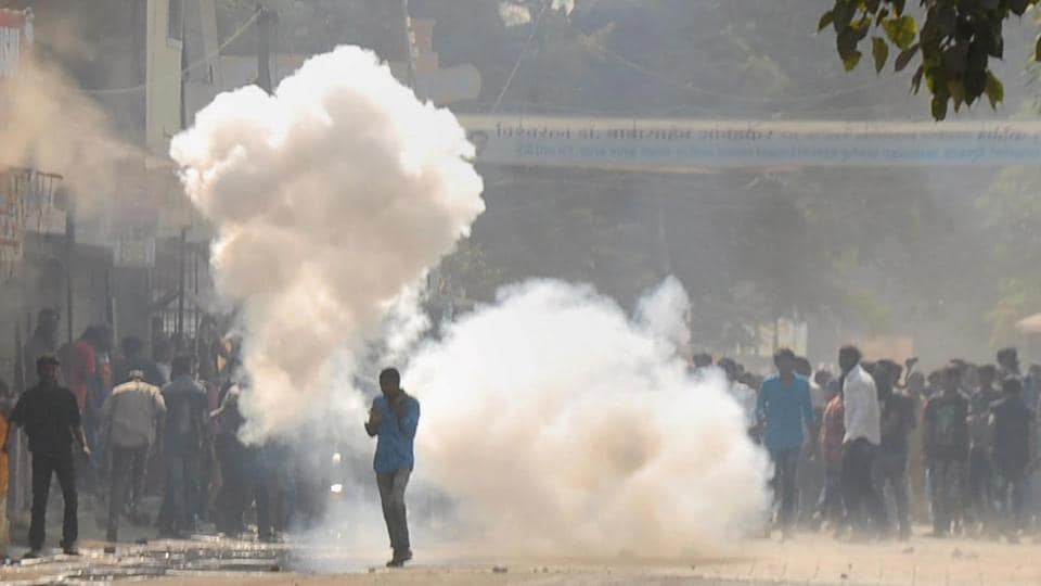 Afile photo shows activists, amid teargas, pelting stones at the police during protests in Aurangabad.