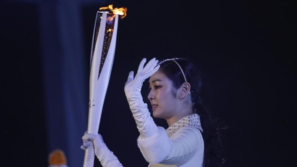 Former figure skater Kim Yuna Kim of South Korea prepares to light the cauldron at the 2018 Winter Olympics.