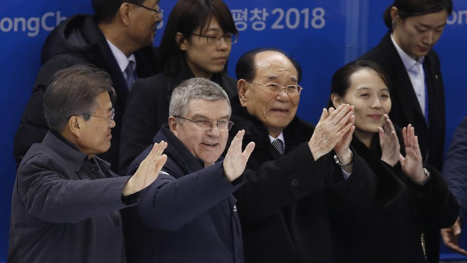 South Korean President Moon Jae-in, IOC president Thomas Bach, North Korea's nominal head of state Kim Yong Nam and Kim Yo Jong, sister of North Korean leader Kim Jong Un, greet players after the preliminary round of the women's hockey game between Switzerland and the combined Koreas at the 2018 Winter Olympics in Gangneung, South Korea, Saturday, Feb. 10, 2018. (