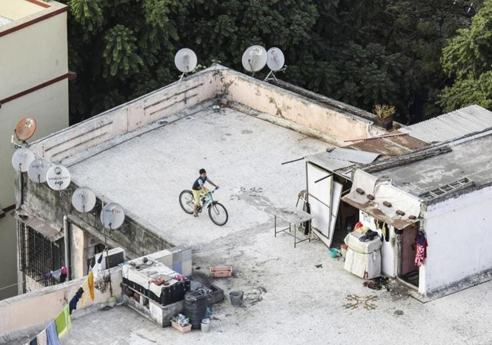 """MUMBAI: """"Kids aren't allowed to play in the compound; it's reserved for parking,"""" says Ashwini Dandwate, 40, who lives with daughters aged 14 and 7 in metropolitan Mumbai. """"There is a podium area, but it's tiled, so they could slip and hurt themselves there. They end up either cycling or watching YouTube. Sometimes they play with their friends in the lobby."""" (Kunal Patil / HT Photo)"""