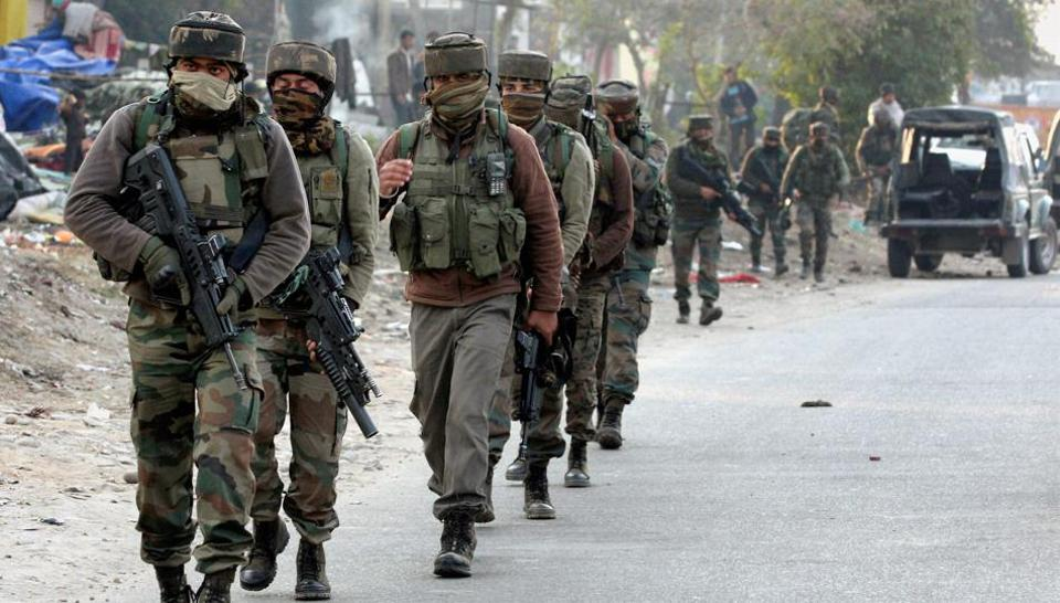 Security personnel take positions during a militants attack at Sunjwan Army camp in Jammu on Saturday.