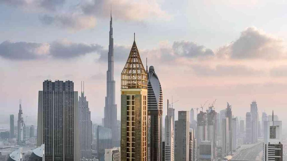 The gleaming gold 75-storey Gevora Hotel stands 356 metres, or nearly a quarter of a mile, tall.
