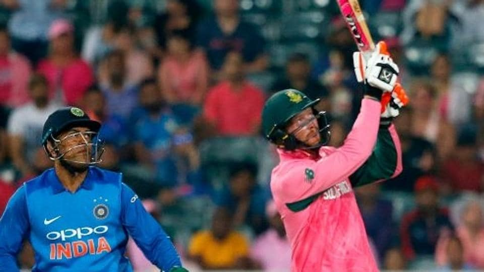 South Africa cricket team's batsman Heinrich Klaasen (right) hits a boundary as India cricket team wicketkeeper MS Dhoni during the 4th ODI (Pink ODI) at the Wanderers Stadium in Johannesburg on Saturday.