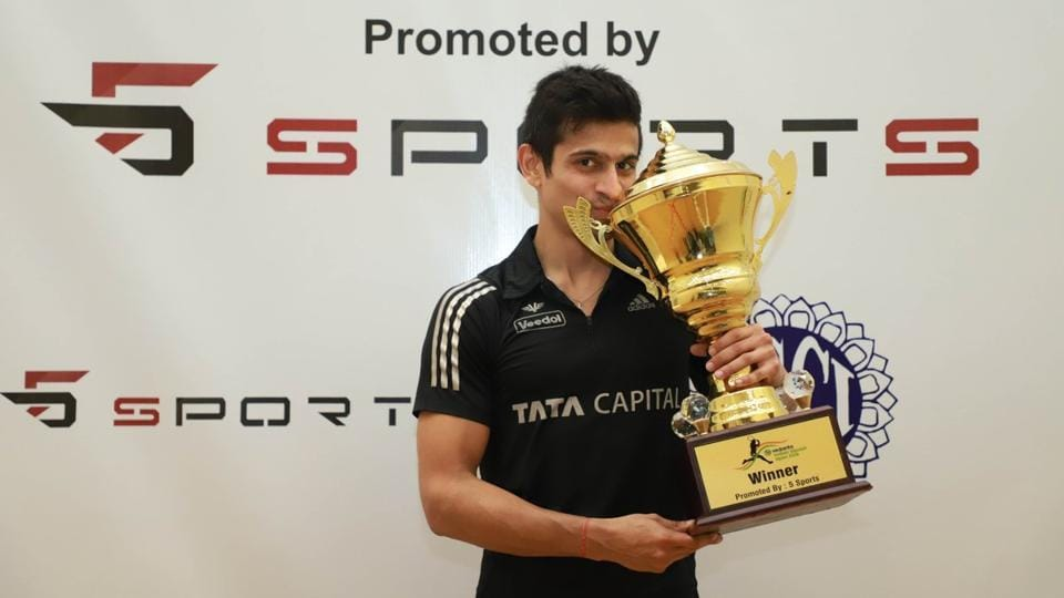 Indian squash player Saurav Ghosal with the Indian Open trophy after winning the title in Mumbai on Sunday.