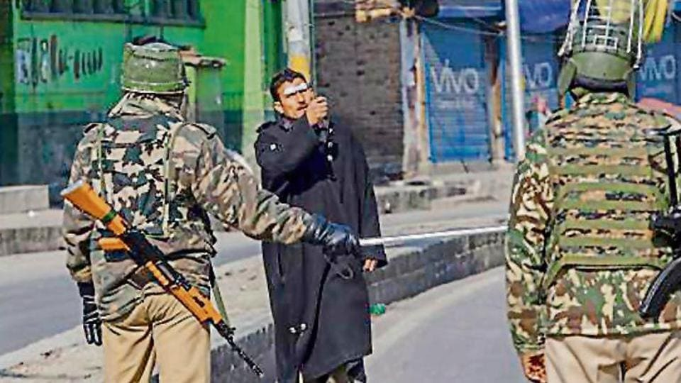 Security forces  stop a pedestrian in Srinagar, where  restrictions were imposed on Friday.