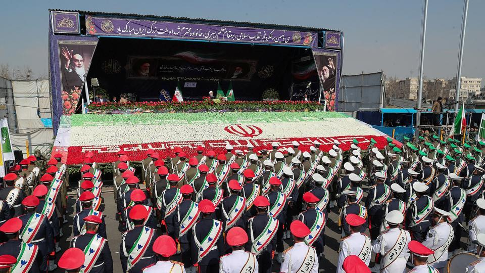 Iranian President Hassan Rouhani gestures as members of Iranian armed forces take part in a rally marking the anniversary of Iran's 1979 Islamic revolution, in Tehran, Iran, February 11, 2018.