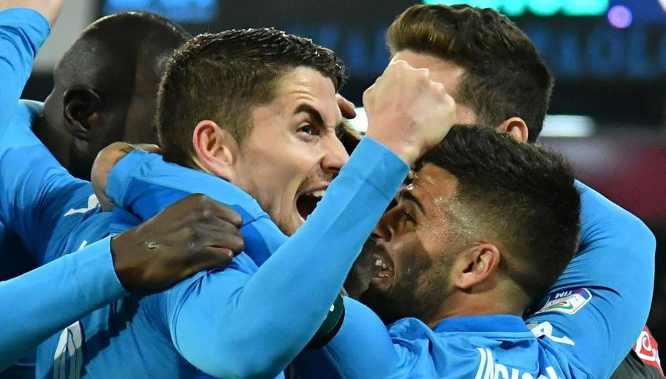 Napoli's players celebrate after scoring a goal during the Italian Serie A football match Nversus Lazio on Saturday.