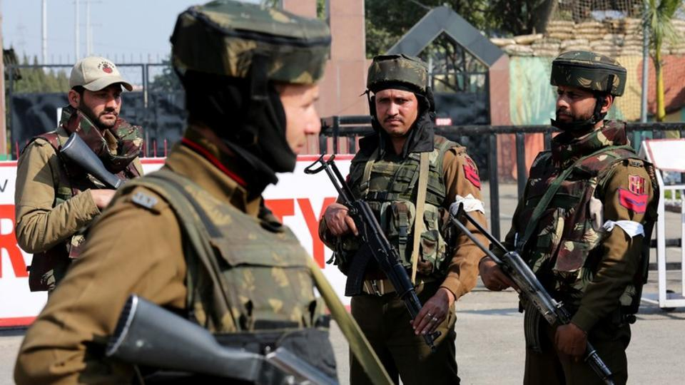 Soldiers stand guard outside an army camp after militants attacked the camp, in Jammu, February 10, 2018.