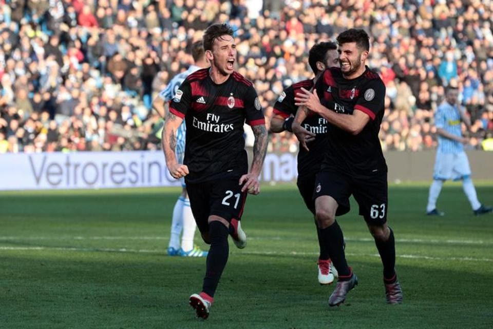 AC Milan's Lucas Biglia, left, celebrates with teammate Patrick Cutrone after scoring his side's third goal, during the Serie A soccer match between Spal and AC Milan at the Paolo Mazza Stadium in Ferrara,Italy, Saturday.
