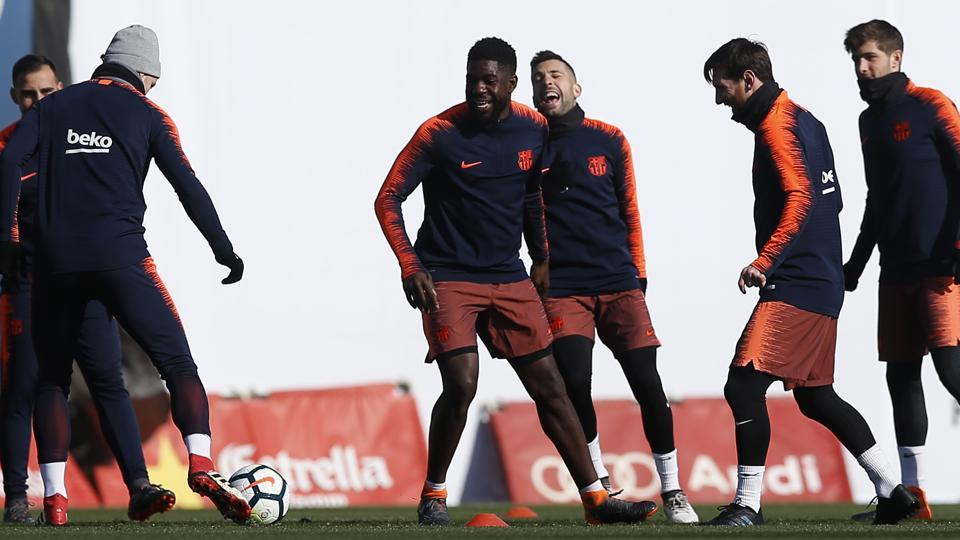 FC Barcelona's Lionel Messi, second right, takes part during a training session with his teammates on Saturday.