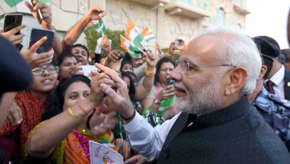 Prime Minister Narendra Modi meets the Indian community in Muscat, Oman, on Sunday.