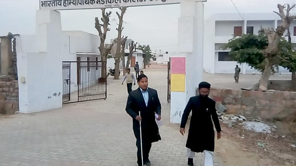 Mohammad Nasir returns without appearing for REET in Bharatpur on Sunday.